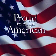 "US flag, ruffled by the wind, with the iconic motto ""Proud to be an American'"